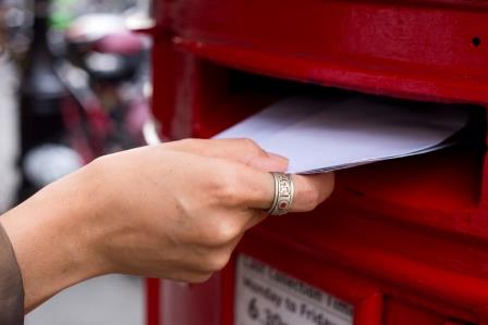 Letter being placed in a postbox