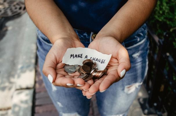 Open hands with coins for fundraising