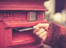 Letters being put in the postbox