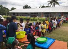 Papua Partners distributing food after the floods
