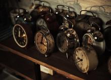 Lots of analogue alarm clocks